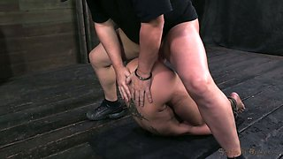 Oiled tied up flexible brunette gets her moist twat pile driven hard