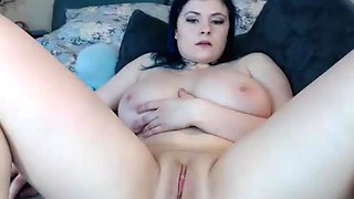 Busty Brunette Masturbating using two dildos