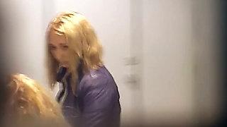 Skinny white chick in black pants filmed in the toilet room