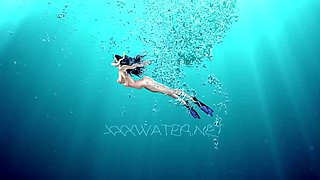 Sexy mermaid Puzan Bruhova performs her hot underwater show