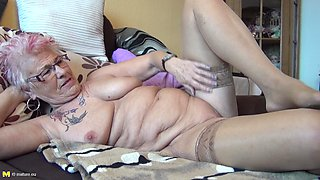 Tattooed granny exposes her big clit for your pleasure