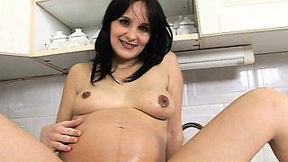 Pretty  pregnant babe gets fucked in the kitchen