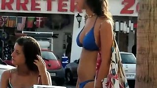 Street voyeur finds a busty brunette in a sexy blue bikini