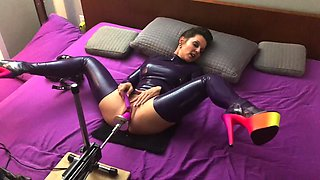 MILF in latex dress and stocking tests fuck machine