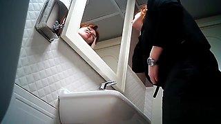Women pee in public toilet 2259