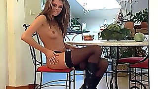 Klara teases in sheer lingerie and leather boots