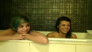 Two mesmerizing emo babes expose their gorgeous bums in the bathroom