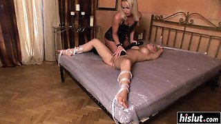 Stunning girls share a monster dildo
