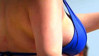 Busty amateur brunette in a sexy bikini enjoys the hot sun