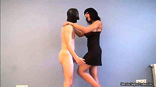 Dominant brunette with big boobs punishes her masked slave