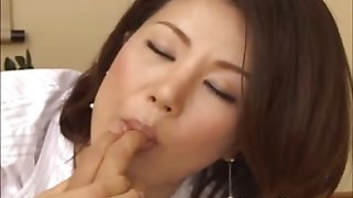 Asian licks fingers while jerking a cock