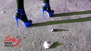 Lady L sexy walking with extreme bluek high heels.
