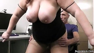 Busty secretary gives titjob and rides cock