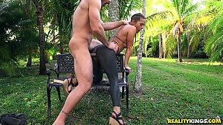 Kinky Abigail Mac enjoys playing with a big pecker outdoors