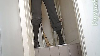 Short haired redhead milf in the public restroom on cam