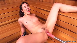 Brunette takes group of machines in sauna