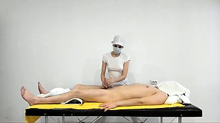 Masked masseuse working her skillful hands on a meat stick