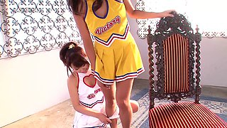 Two Japanese cheerleaders stretching and having fun with their pussies