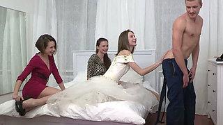 Two bride maids teaching bride good sucking skills