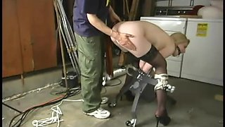 Petite blondie is forced to suck a dildo that's been in her twat