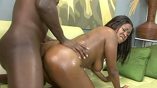 Black hottie with oiled booty Mahogany Bliss is fucked doggy style