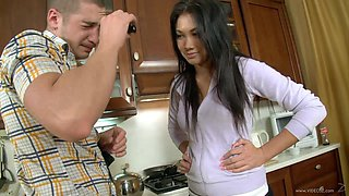 Sexy brunette Daisy enjoys some rear banging in the kitchen