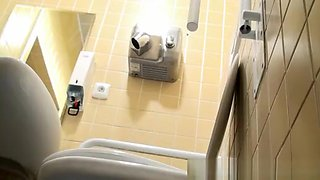 Spy in public toilet