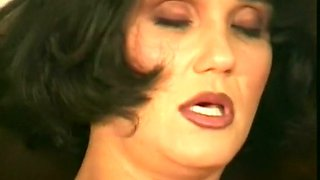 Fine mature brunette German lady in the bedroom masturbates with a toy