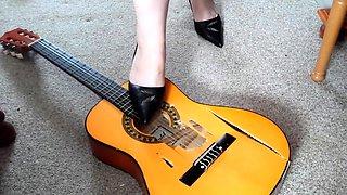 Hot amateur foot fetishist in high heels destroys a guitar
