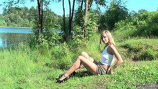 Stunning and sassy blonde Russian girl spreads her legs