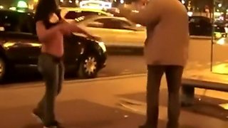Drunk girl stripping in front of a club