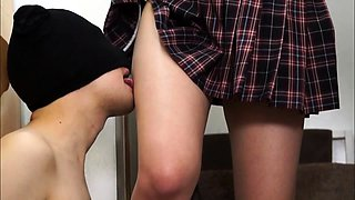 Sensual Oriental teen in uniform teases a cock with her feet