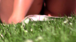Amateur babe in black panties enjoys the hot sun in the park