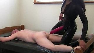Latex Mistress ass fucks slave
