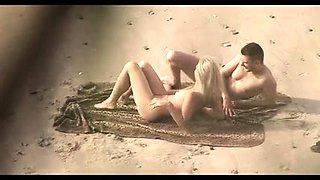 Beach voyeur shoots a beautiful blonde getting fucked hard