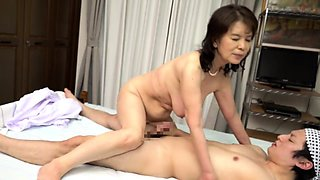 Japanese granny with big natural boobs cums hard on a cock