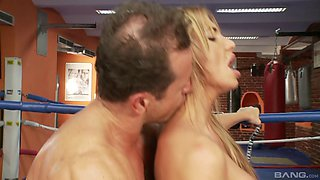 Busty cougar takes a bulky wrestler's schlong greedily