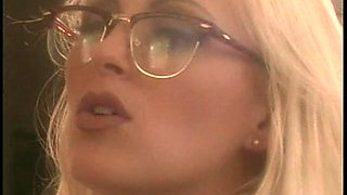 Horny blonde lesbian arranging books then drilled using toys