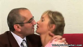 Young plaid haired chick gets wet with her teacher\'s hands.