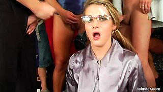 Naughty babe with glasses attacked by a bunch of randy men