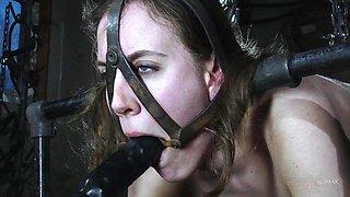 slave bondaged and spitroasted by fucking machine