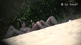 An attractive couple gets voyeur cammed on the nude beach