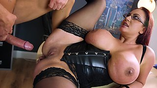 A redhead with a nice round ass is having her thick body penetrated