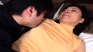 Hot Asian mom uses the art of seduction to fuck a young cock