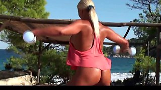 Blonde milf working out naked on the beach