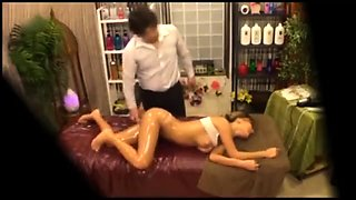 Alluring Asian babe gets massaged and fucked on hidden cam