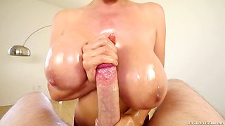 A big cock fucks her huge tits and explodes on her face