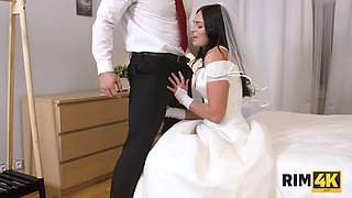 RIM4K. Magnificent brunette in wedding dress worships grooms ass