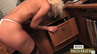 Naked housewife in the kitchen