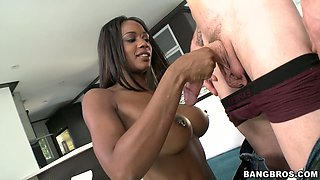 Outrageous ebony bombshell Janine blows and rides white dick